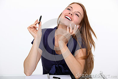 Joyful woman at a desk