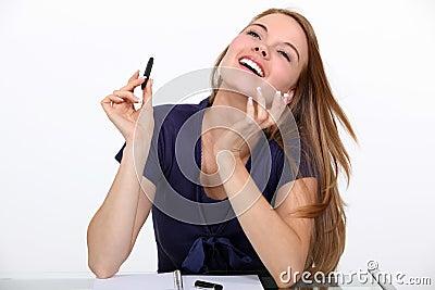 Joyful woman at a desk