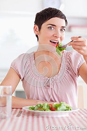 Joyful Woman eating salad