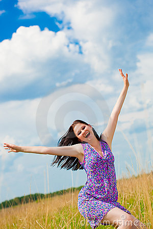 Joyful woman in the field