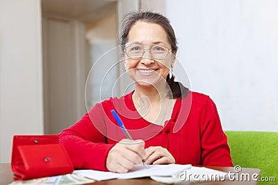 Joyful woman fills in the questionnaire