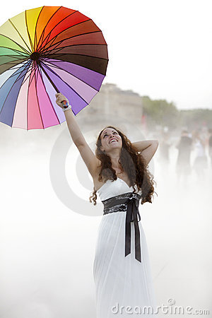Joyful woman in fog