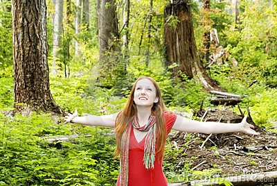 Joyful woman in forest
