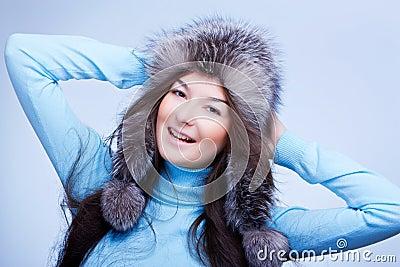 Joyful woman in fur cap