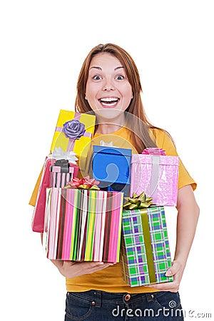 Joyful woman with gift boxes