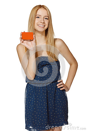 Joyful woman holding blank credit card