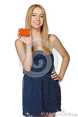 Joyful woman holding blank credit card