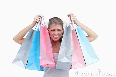 Joyful woman holding shopping bags