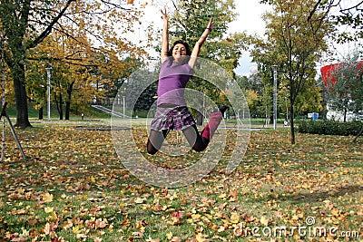 Joyful woman jumping