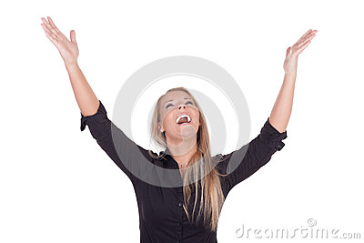 Joyful woman laughing with raised arms