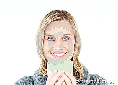 Joyful woman with a pullover enjoying a hot coffee