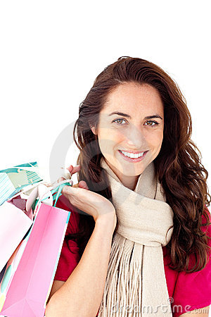 Joyful woman with a scarf holding shopping bags