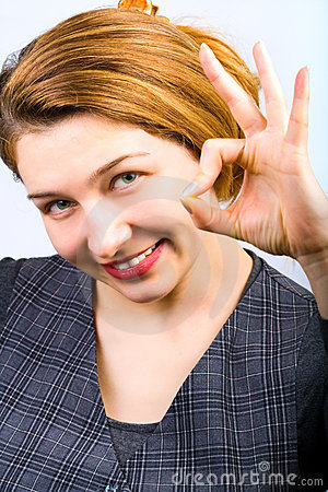 Joyful woman showing ok sign