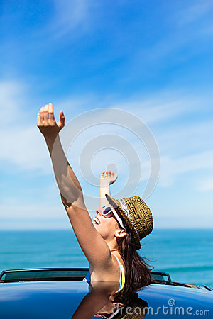 Joyful woman on summer car travel