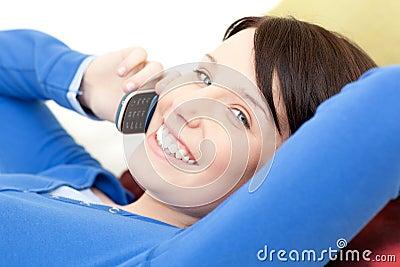 Joyful woman talking on phone