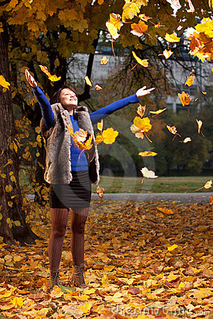 Free Joyful Woman Throwing Autumn Leaves Stock Photo - 22228580