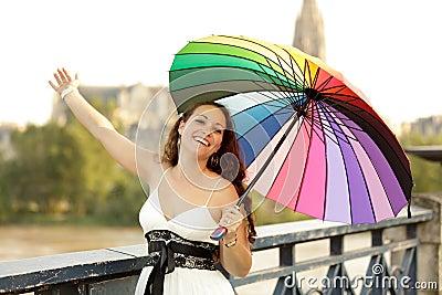 Joyful woman with umbrella