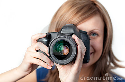 Joyful woman using a camera