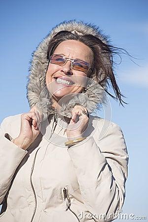 Joyful Woman warm winter jacket outdoor