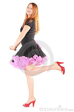 Joyful woman wearing dress and shoes is posing