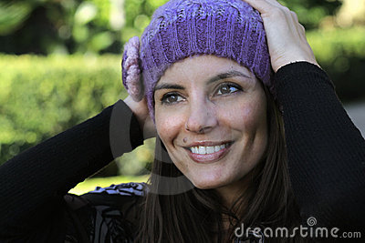 Joyful woman with wool hat
