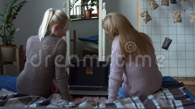 Joyful women with laptop shopping on line at home stock footage