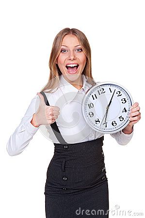 Joyful young businesswoman holding clock