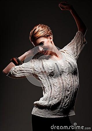 Joyful young woman dancing