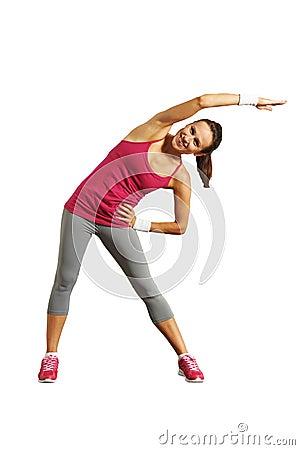 Joyful young woman doing exercises