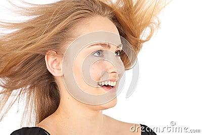 Joyful young woman with waving hair