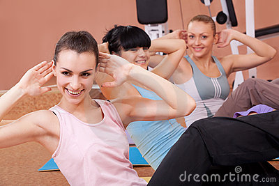Joyful young women working out