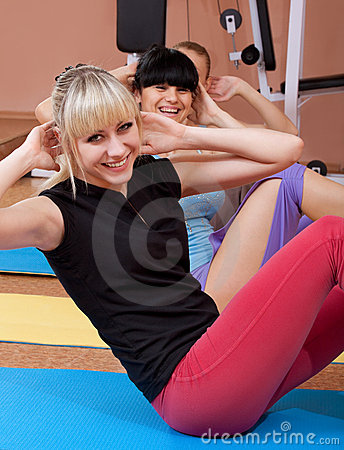 Joyful young women working out