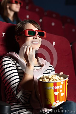 Joyfull woman at the cinema