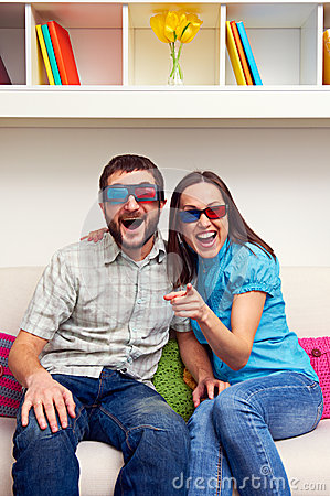 Couple watching comedy and laughing