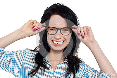 Joyous woman holding her spectacles