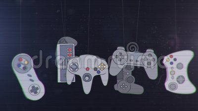 Joysticks of different Game Consoles Hanging and Swinging Stock Photo