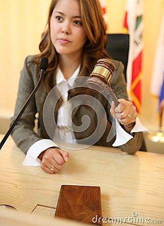 Judge Striking the Gavel (Focus on Gavel)