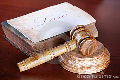 Judges gavel with very old book