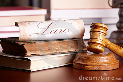 Judges gavel with very old books