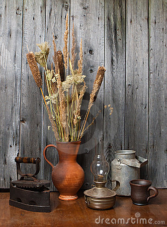 Jug with  dry reeds and old things