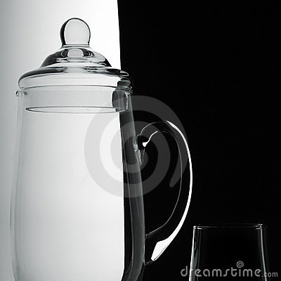 Jug and glass on a black-and-white background