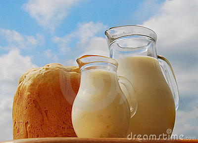 Jug with milk and bread