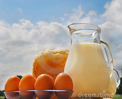 Jug with milk, bread and eggs