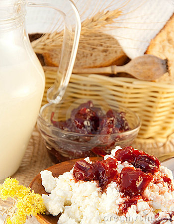 Jug with milk and jam