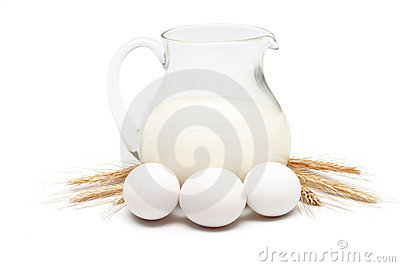Jug of milk with wheat and eggs