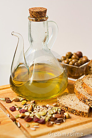 Jug of Olive Oil with Olives.