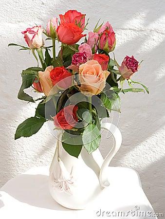 Jug of roses.