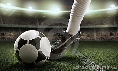 Jugador de fútbol en estadio