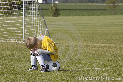 Jugador de fútbol triste
