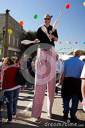 Juggler walks on stilts Editorial Stock Photo